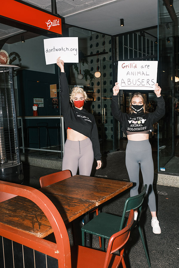 Stefania Ferrario and Tash Peterson protesting at Grill'd